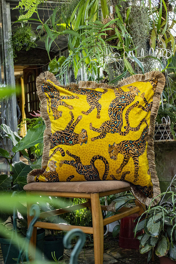 A pillow done in the Cheetah Kings fabric from Ngala Trading Co.
