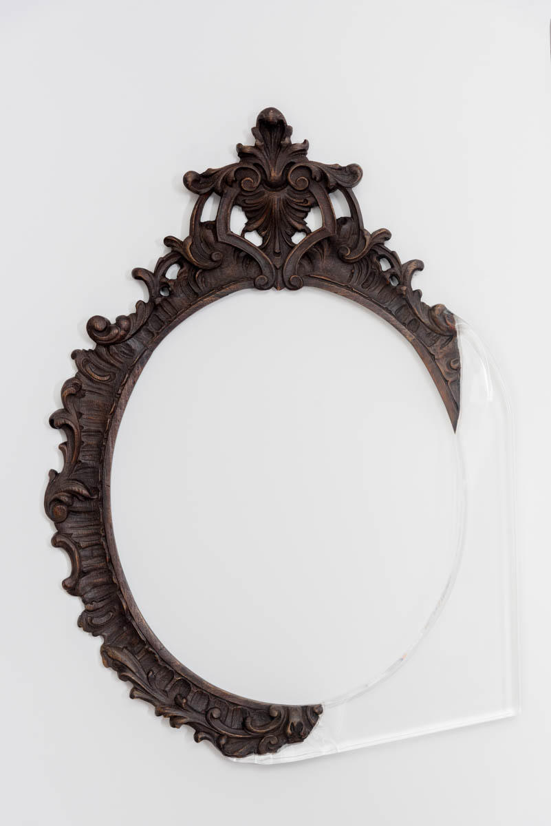 A hand-carved mirror gets a second chance with an injection of modern materials.