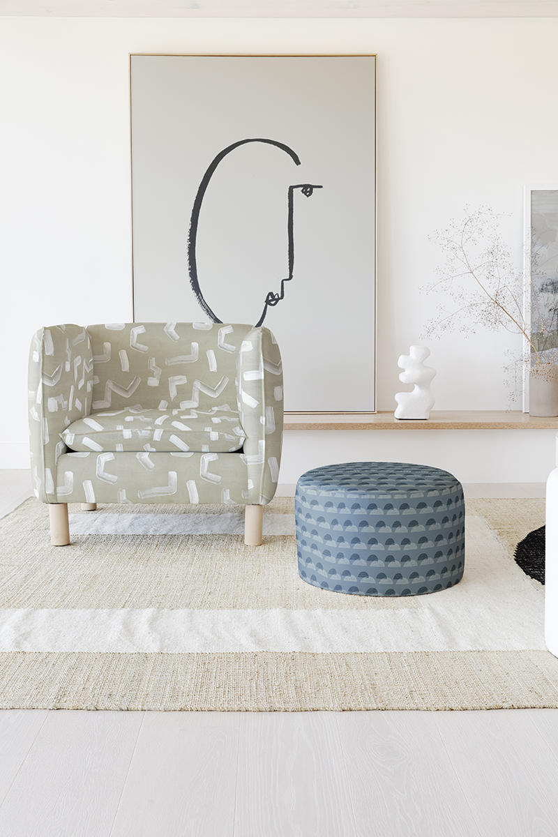 Brushstroke by Nashville, Tennessee–based artist Angela Simeone appears on the armchair, while the ottoman is upholstered in Finesse by Alicia Youngken of Atlanta.