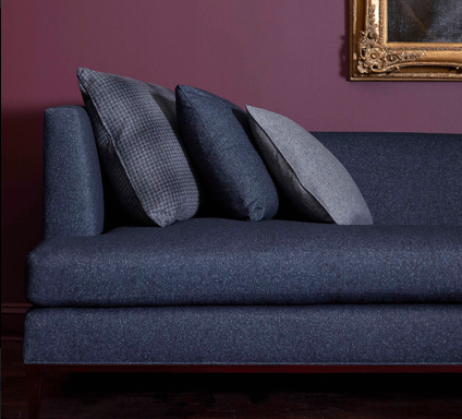 Philip Gorrivan Collection. On Sofa: Calhoun in Empire Blue; On Left Pillow: Monfort in Elephant Gray; On Middle Pillow: Calhoun in Empire Blue; On Right Pillow: Calhoun in Elephant Gray.