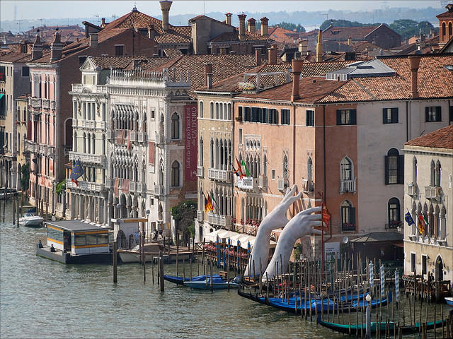 "Lorenzo Quinn's ""Support"" sculpture at the Grand Canal in Venice, Italy at last year's Biennale; photo by JEAN-PIERRE DALBÉRA"