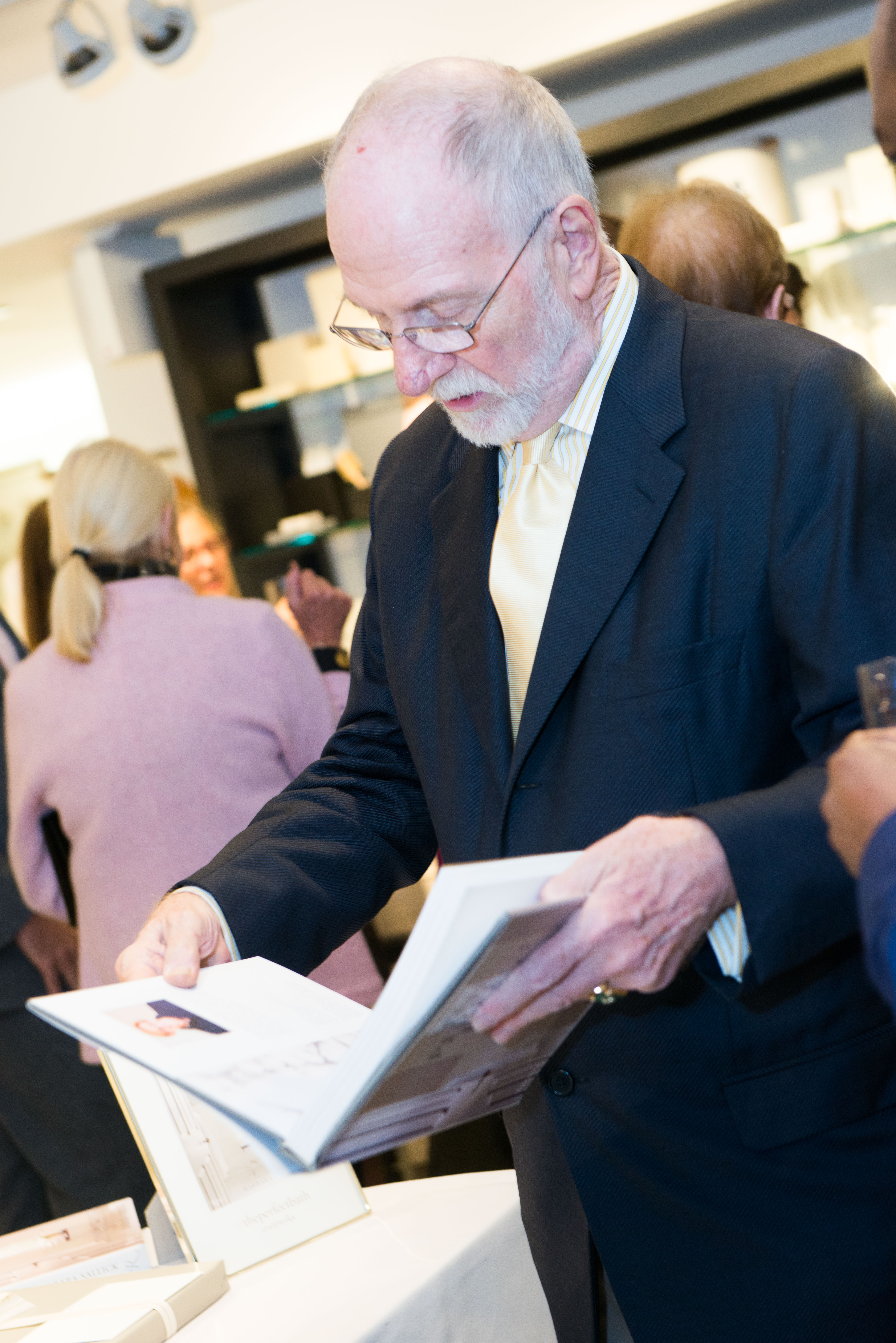 Christopher Jones looking at his copy of 'The Perfect Bath'
