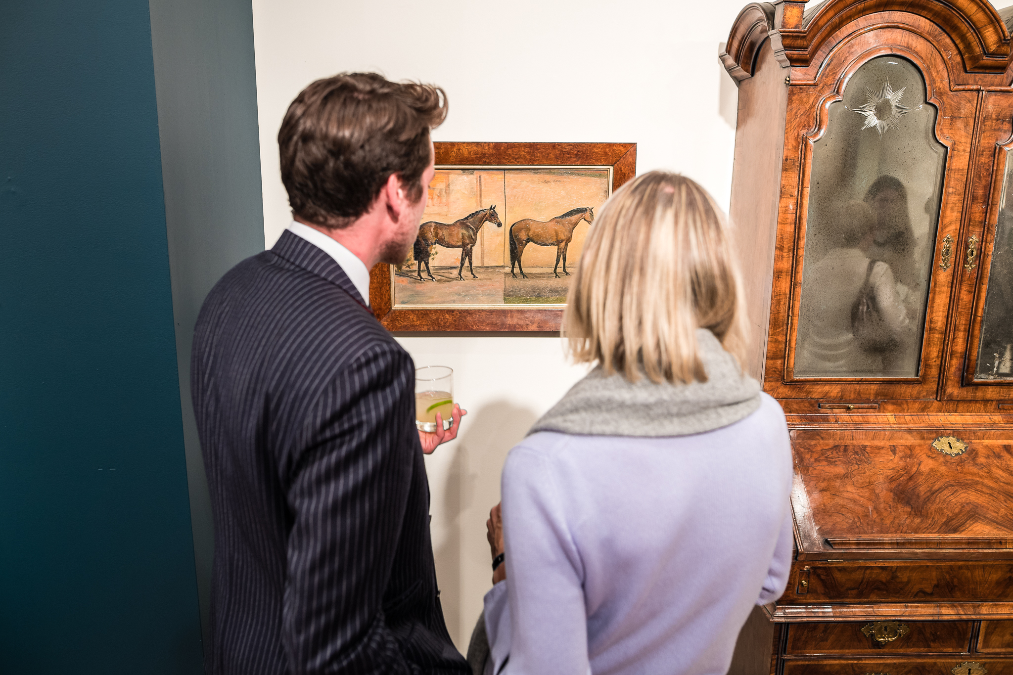 Guests viewing the Decorative Arts Sales exhibition