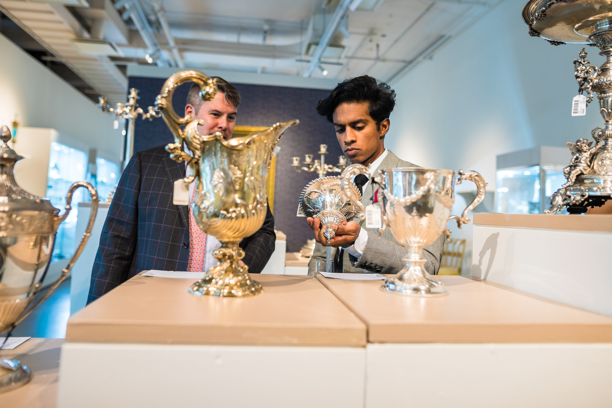 John Ward, head of department, silver & vertu and Specialist at Sotheby's, and Rajiv Surendra perusing Silver