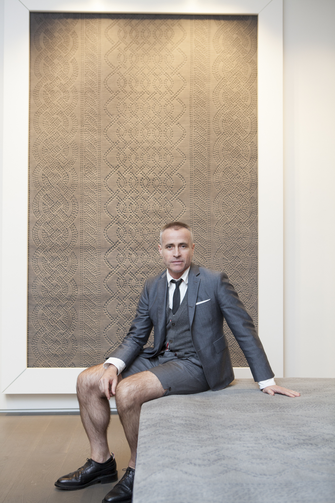 Thom Browne in front of the Cable Knit Grey rug
