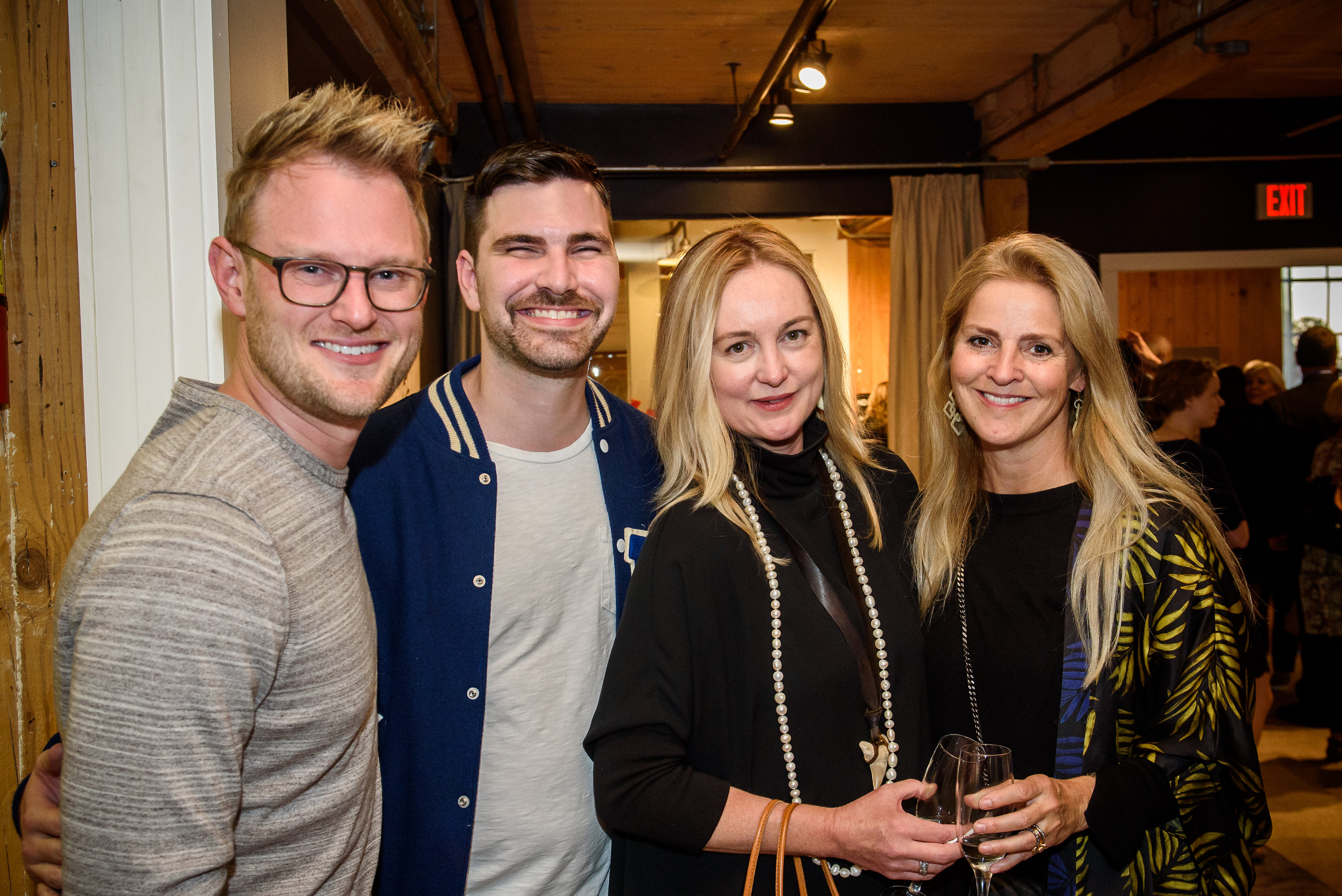 Bobby Berk (left) with Courtney Pisarik (right) and guests