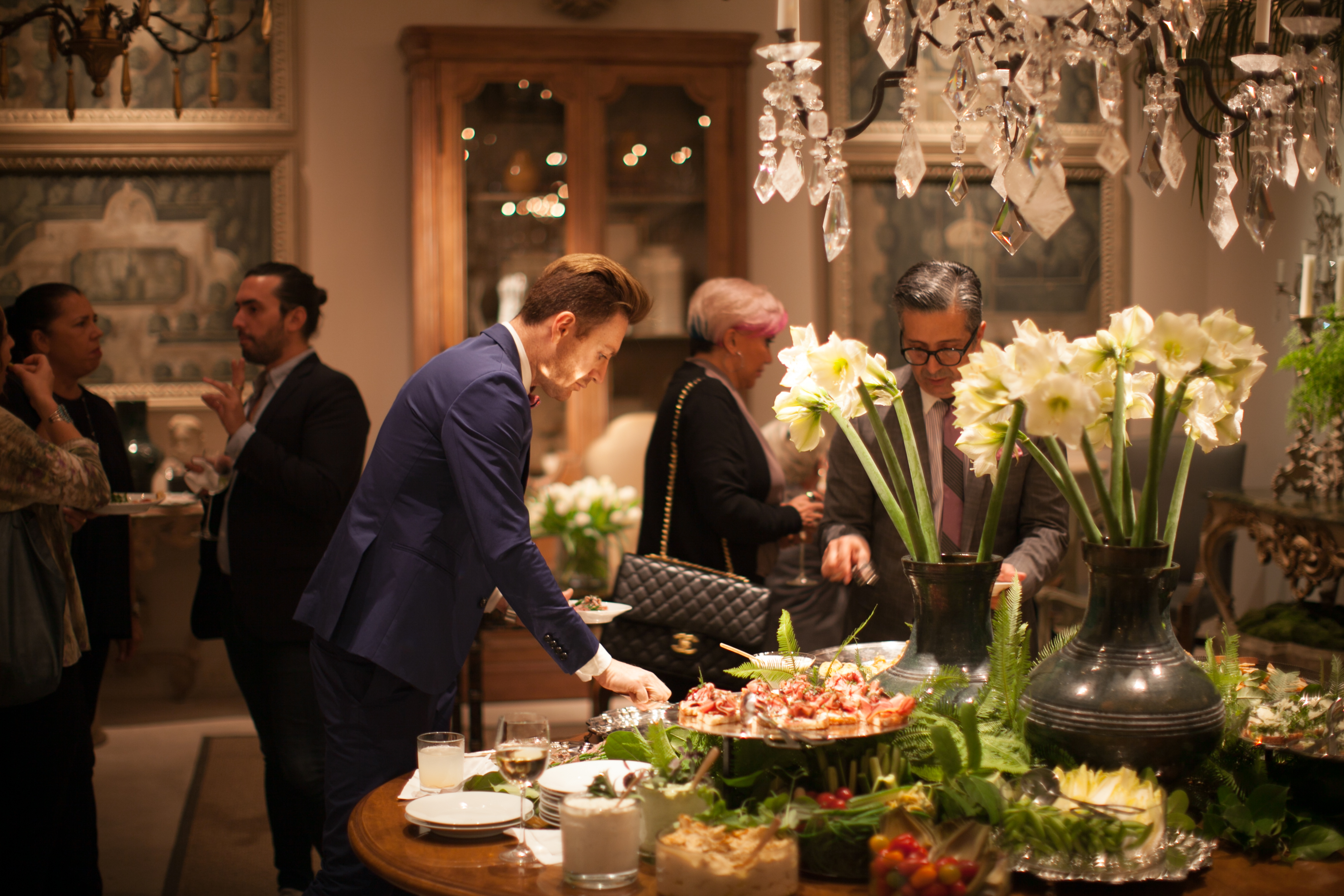 Guests enjoy hors d'oeuvres at the party.