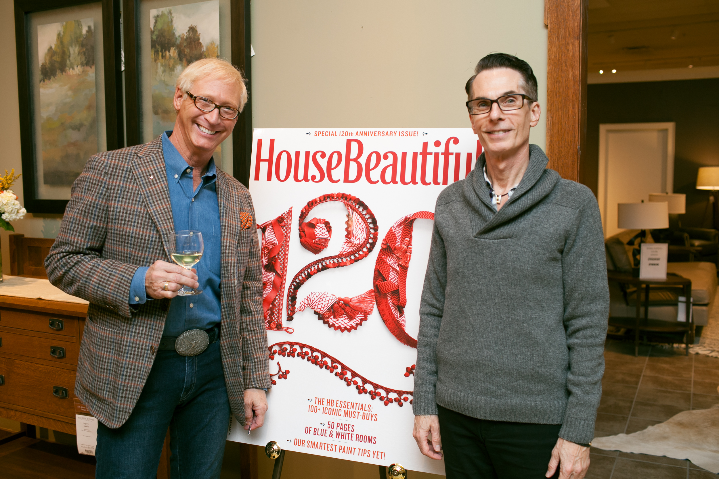 Guests pose with the House Beautiful anniversary cover.