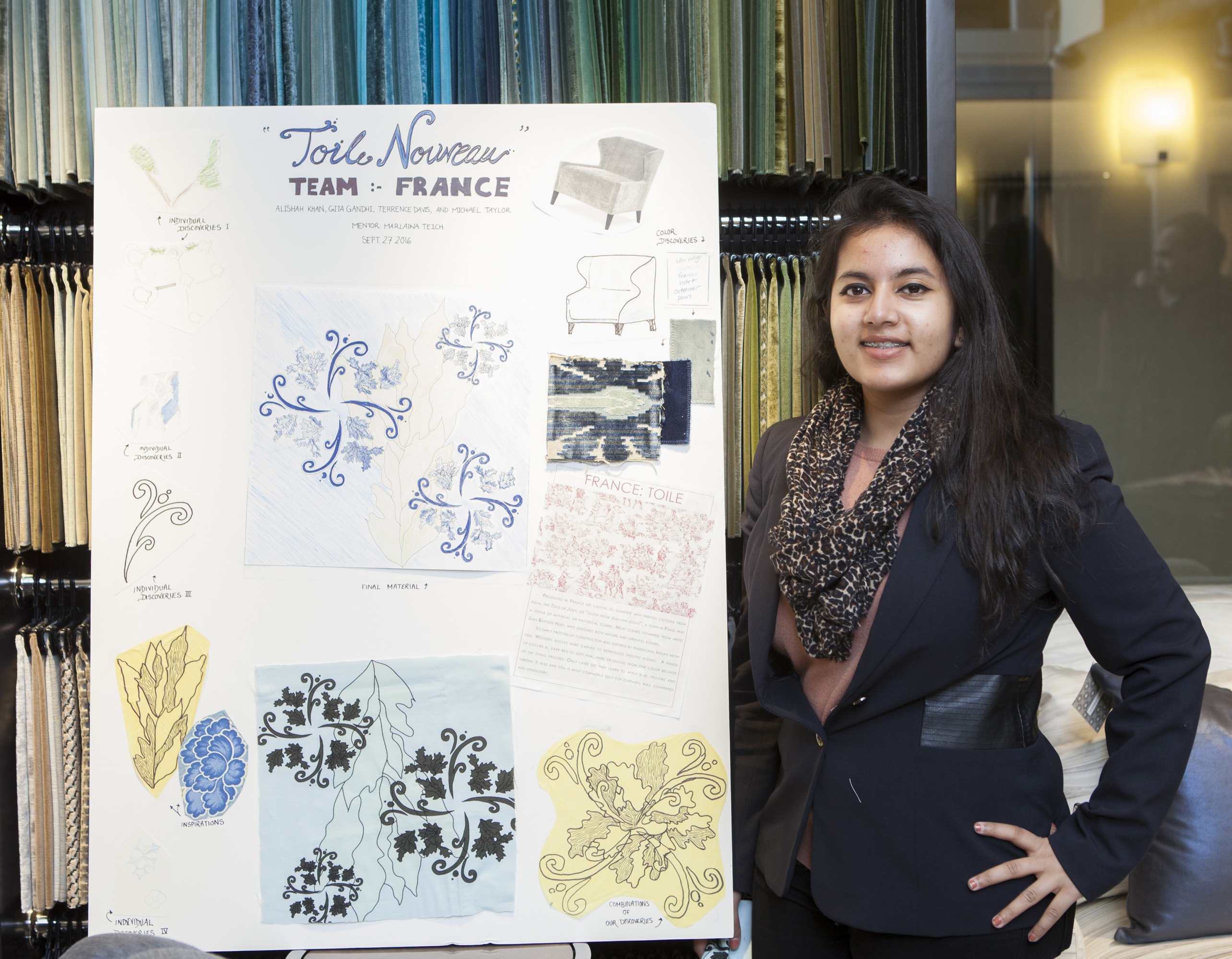 NYIT student Alishah Khan with the Team France design board