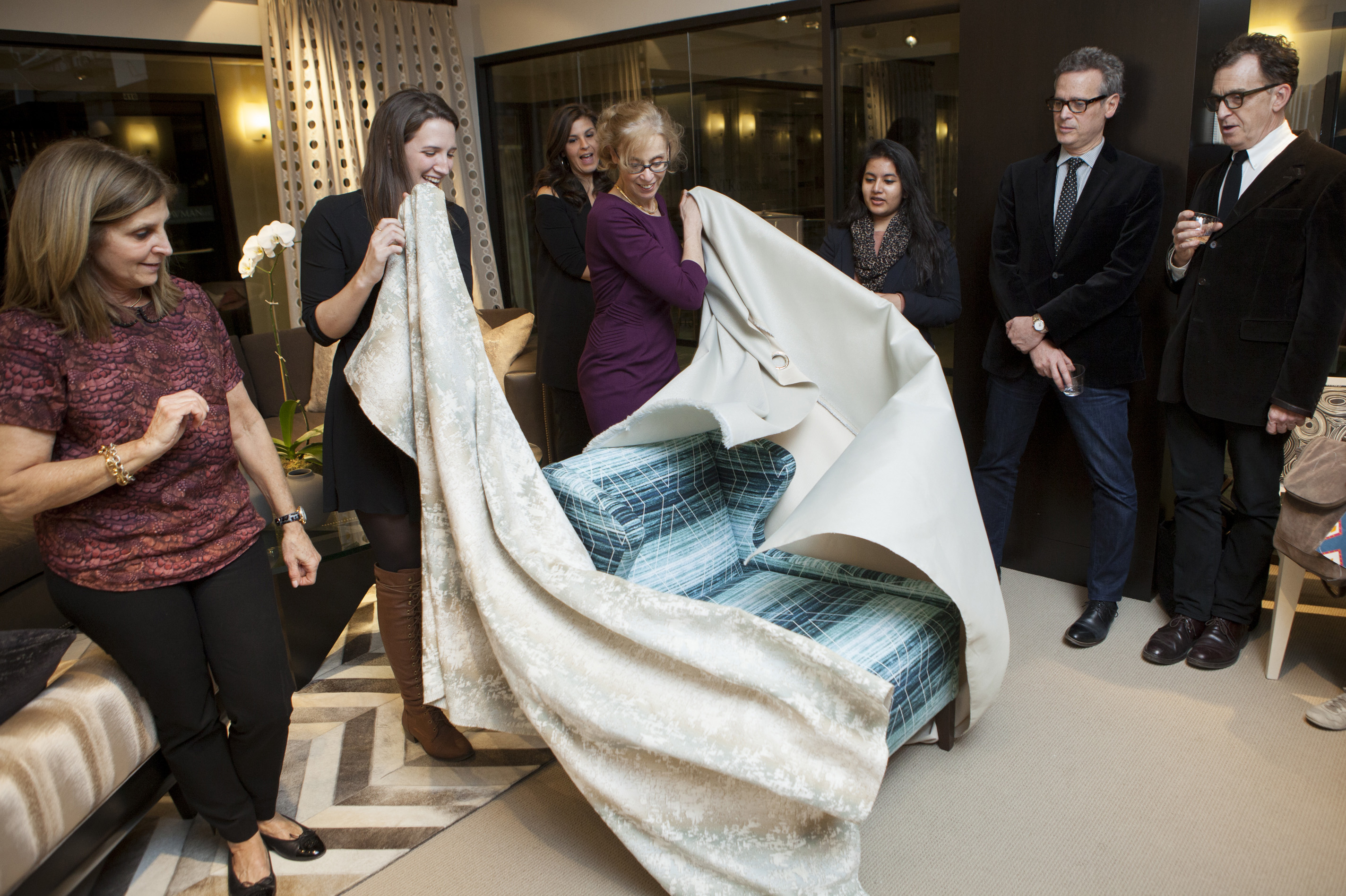 Kravet showroom manager Sheela Herr and ASID student representative Bonnie Hoeker unveil the winning team's design.