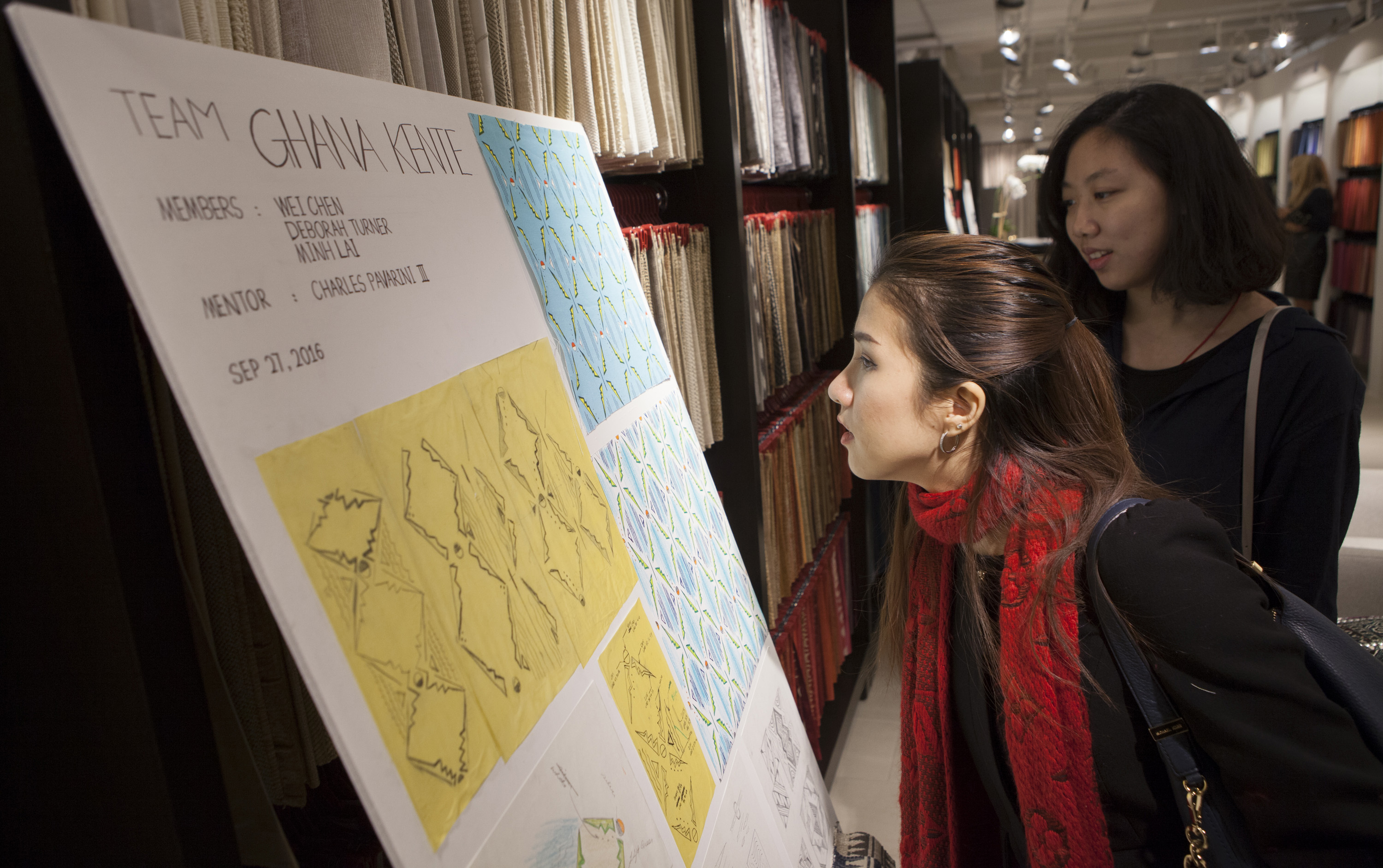 NYSID MFA student Minh Lai and SVA student Wei Chen check out their design board.