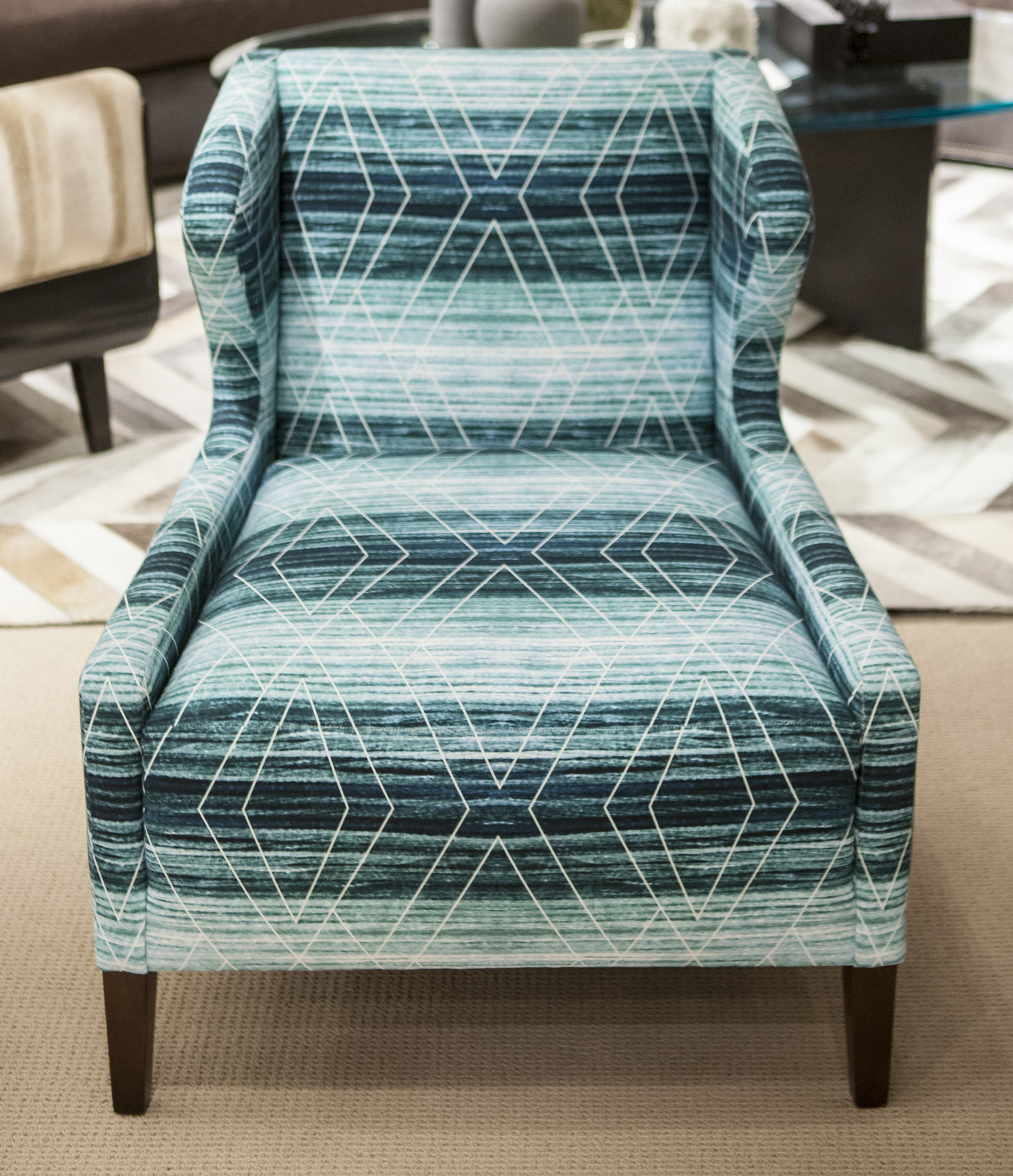 The winning team's fabric upholstered on the Kravet Williams Chair