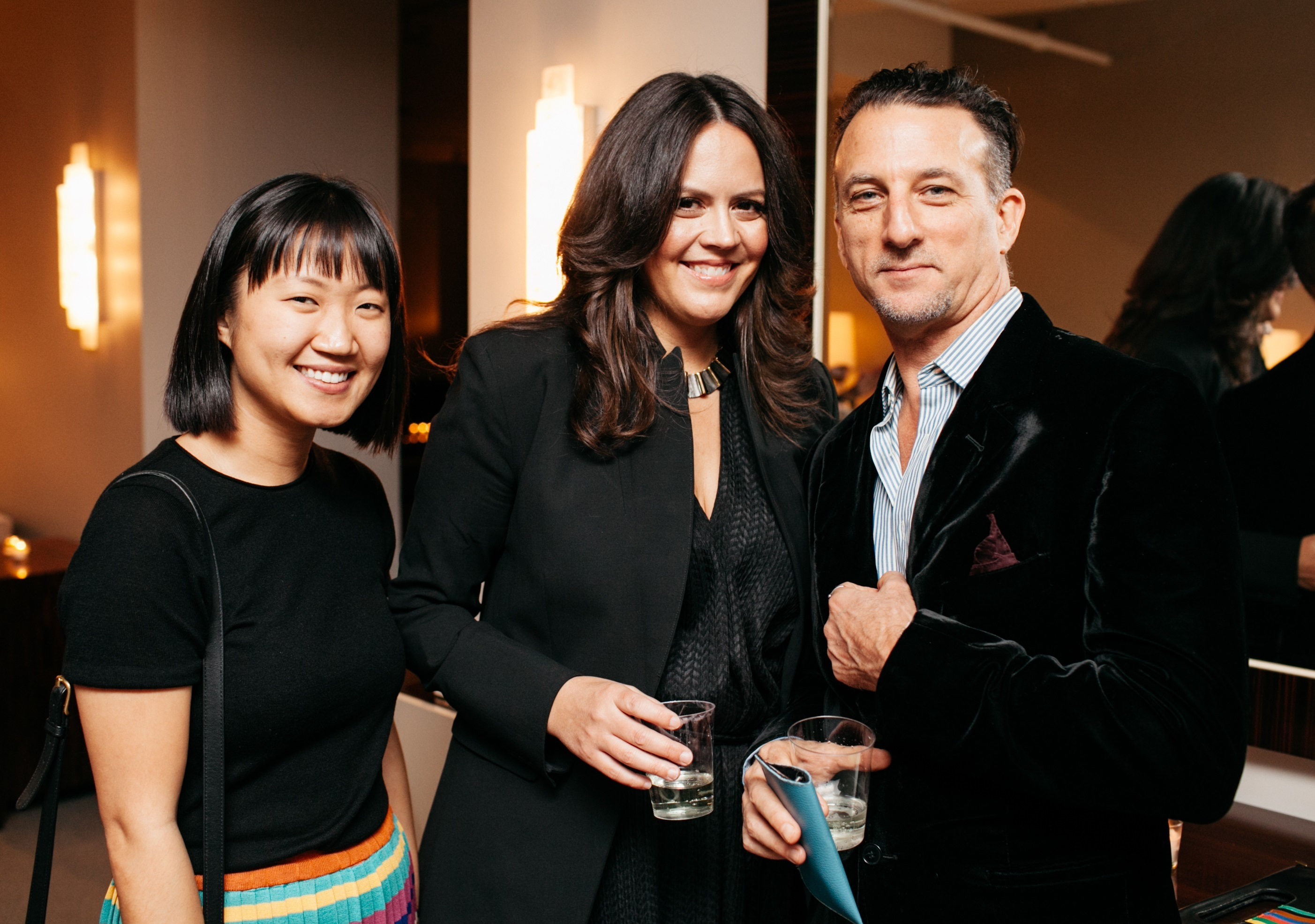Sunny Lee and Elena Frampton from Frampton Co., DESIGN magazine's cover designer, pose with photographer Jeffrey Rothstein