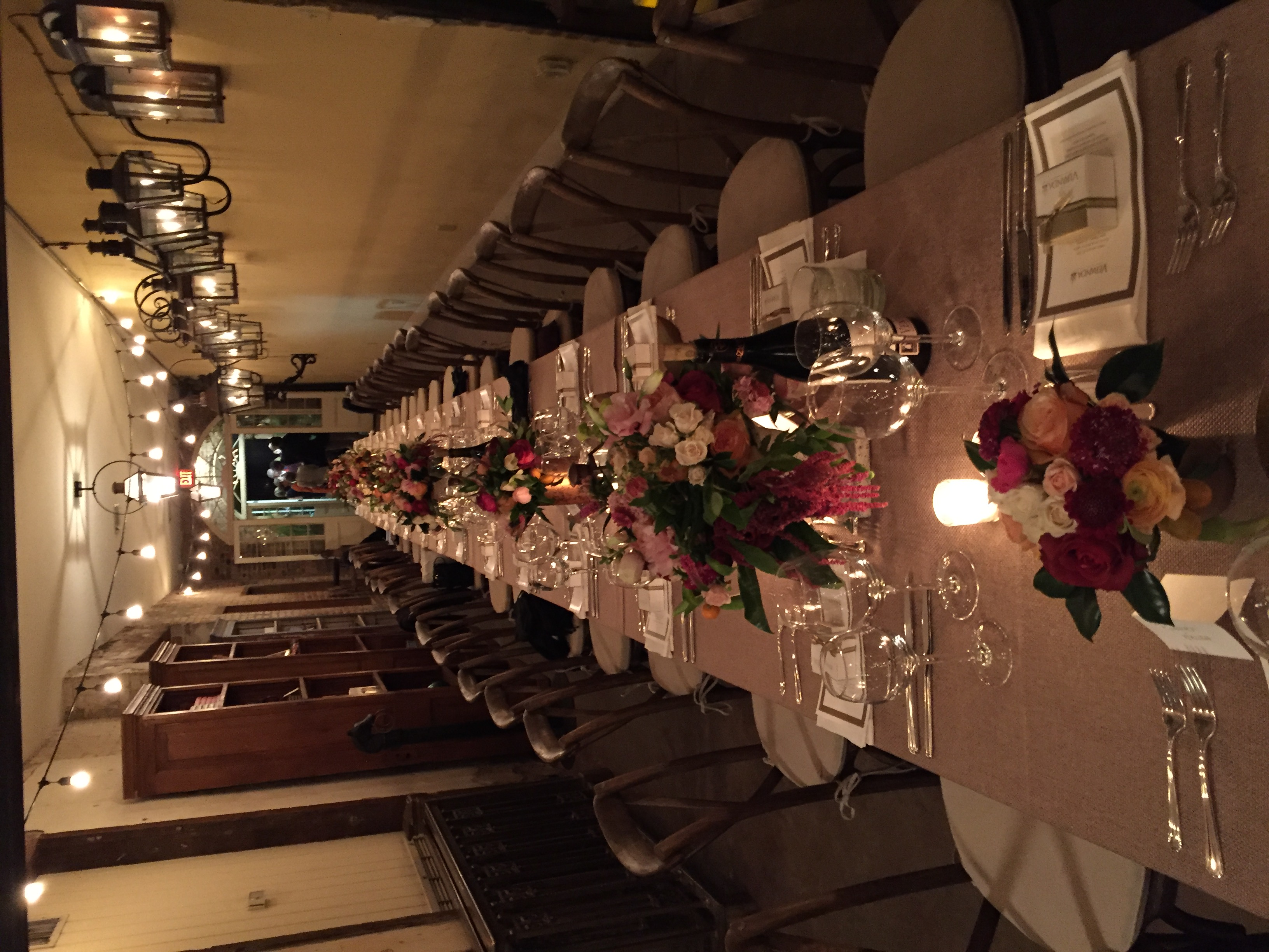 The table is set for dinner at Bevolo Gas & Electric Lights.