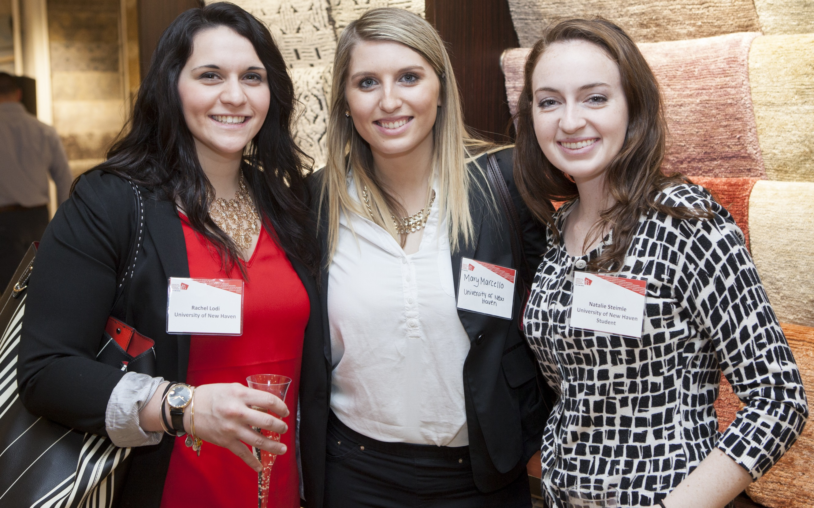Rachel Lodi, Mary Marcello and Natalie Steimle, students at the University of New Haven