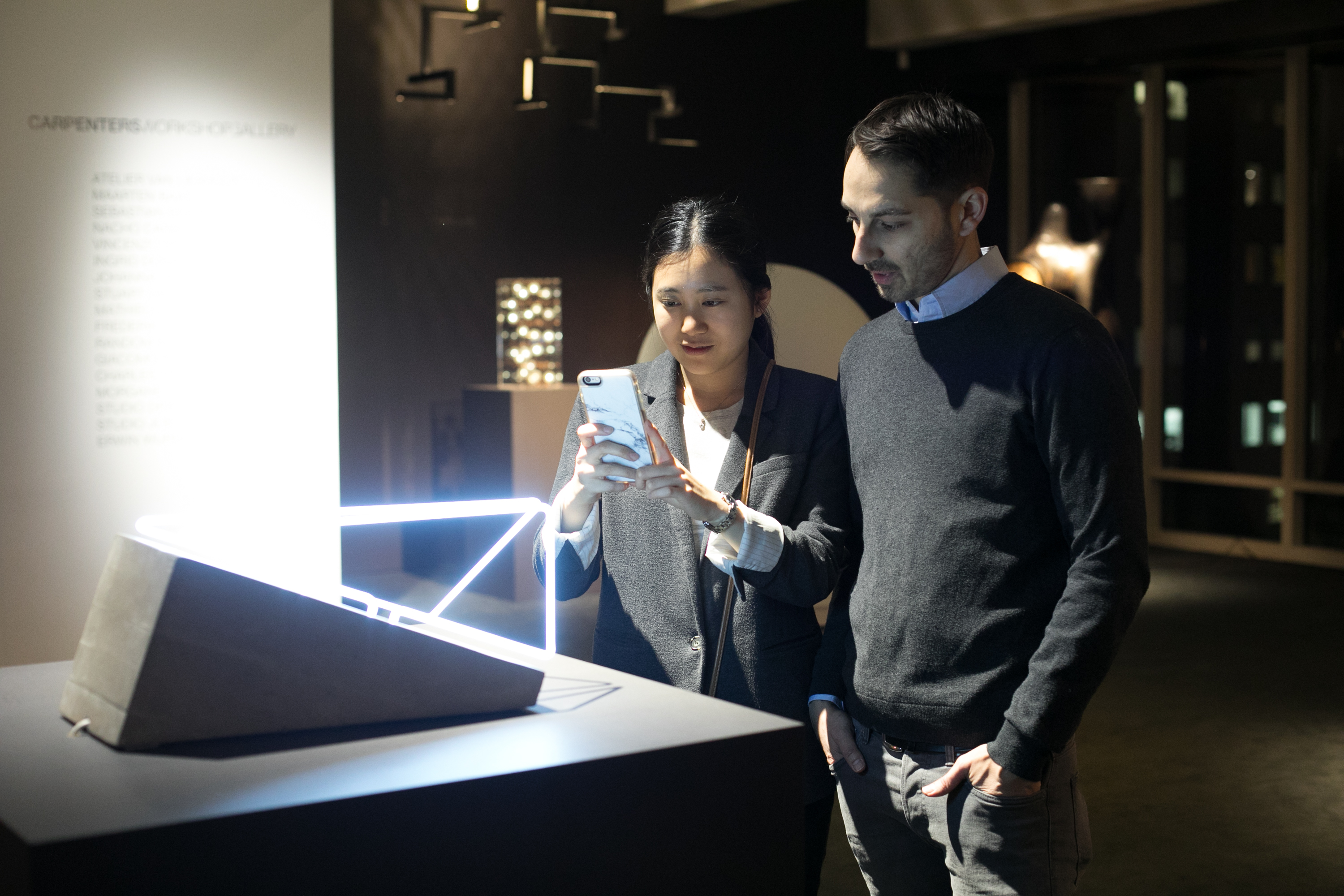 Students Lucy Wang and Patrick Pitu admire the fixture 'Open Space' by Morgane Tschiember.