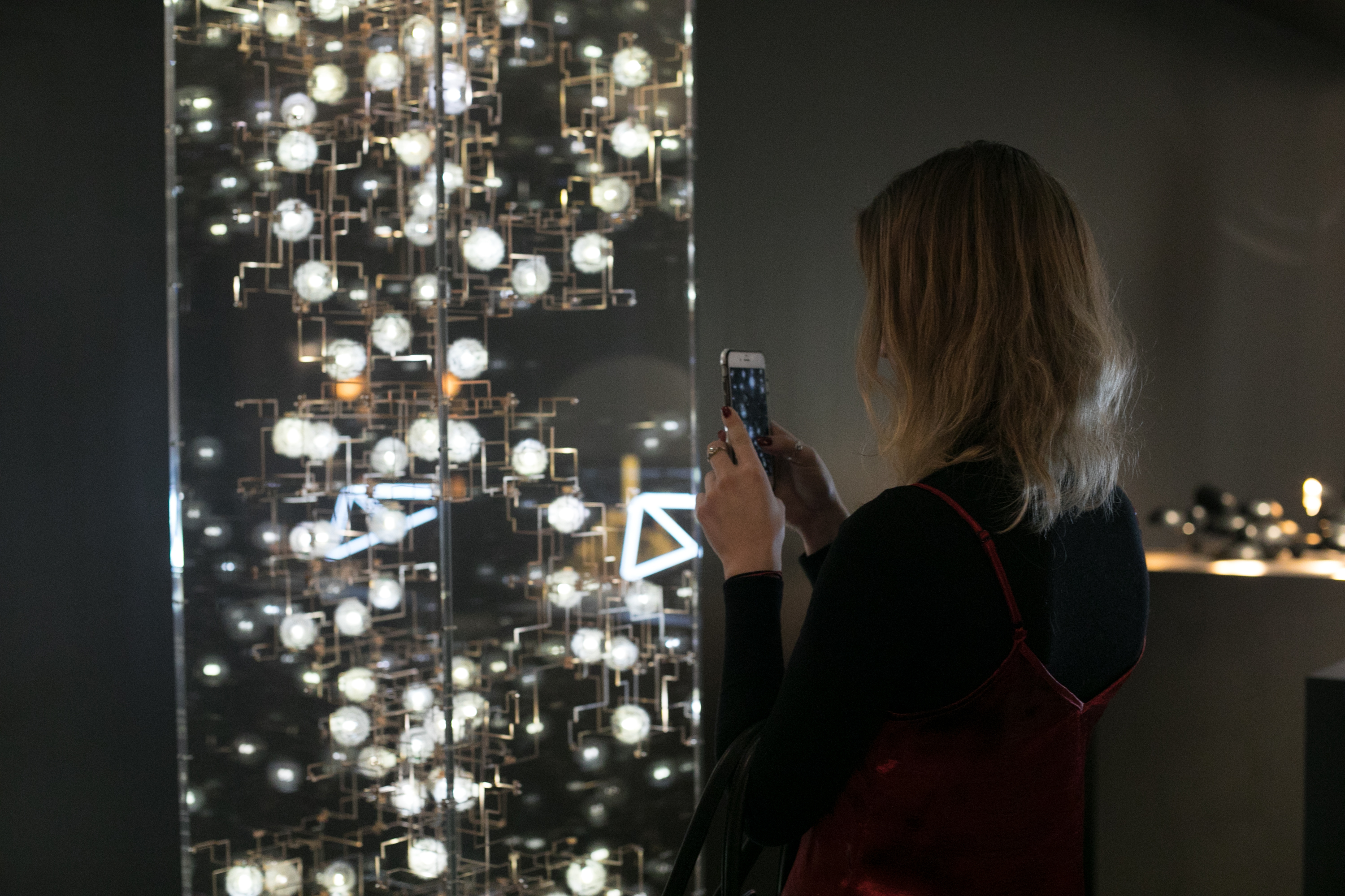 Student Anna Harea gets a closer look at  'Fragile Future' by Studio Drift
