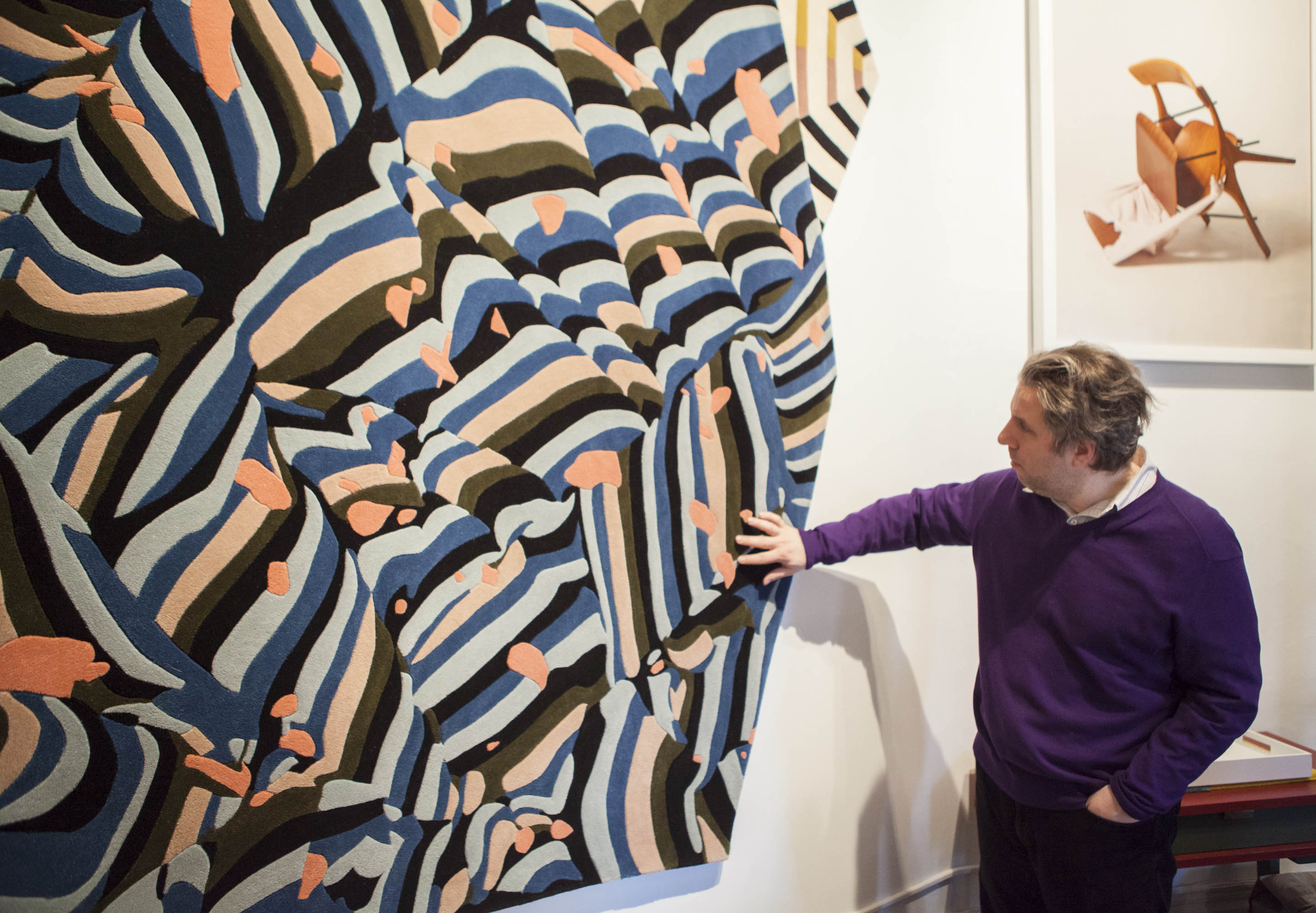 NYSID ASID student Tom Sembros getting a better feel for the 100% New Zealand wool Banner rug