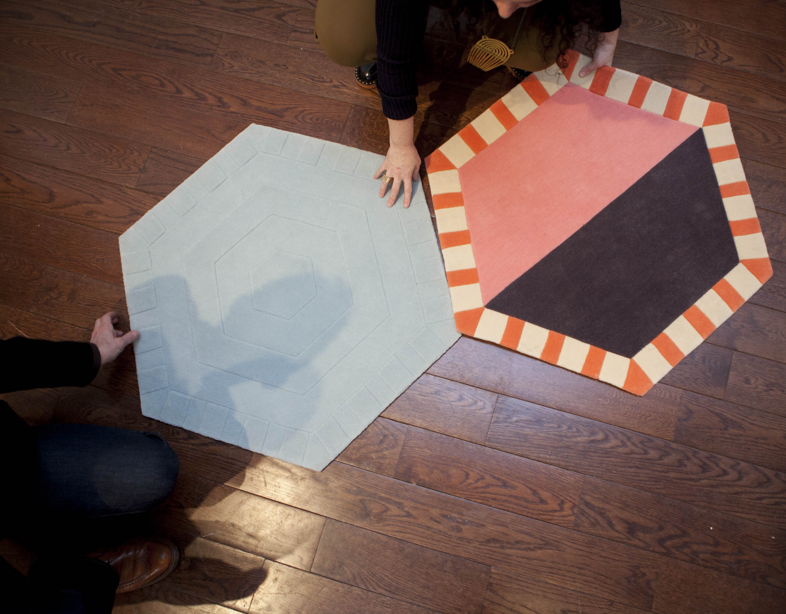 Attendees get a better feel for the modular rugs of the Kinder Ground series.