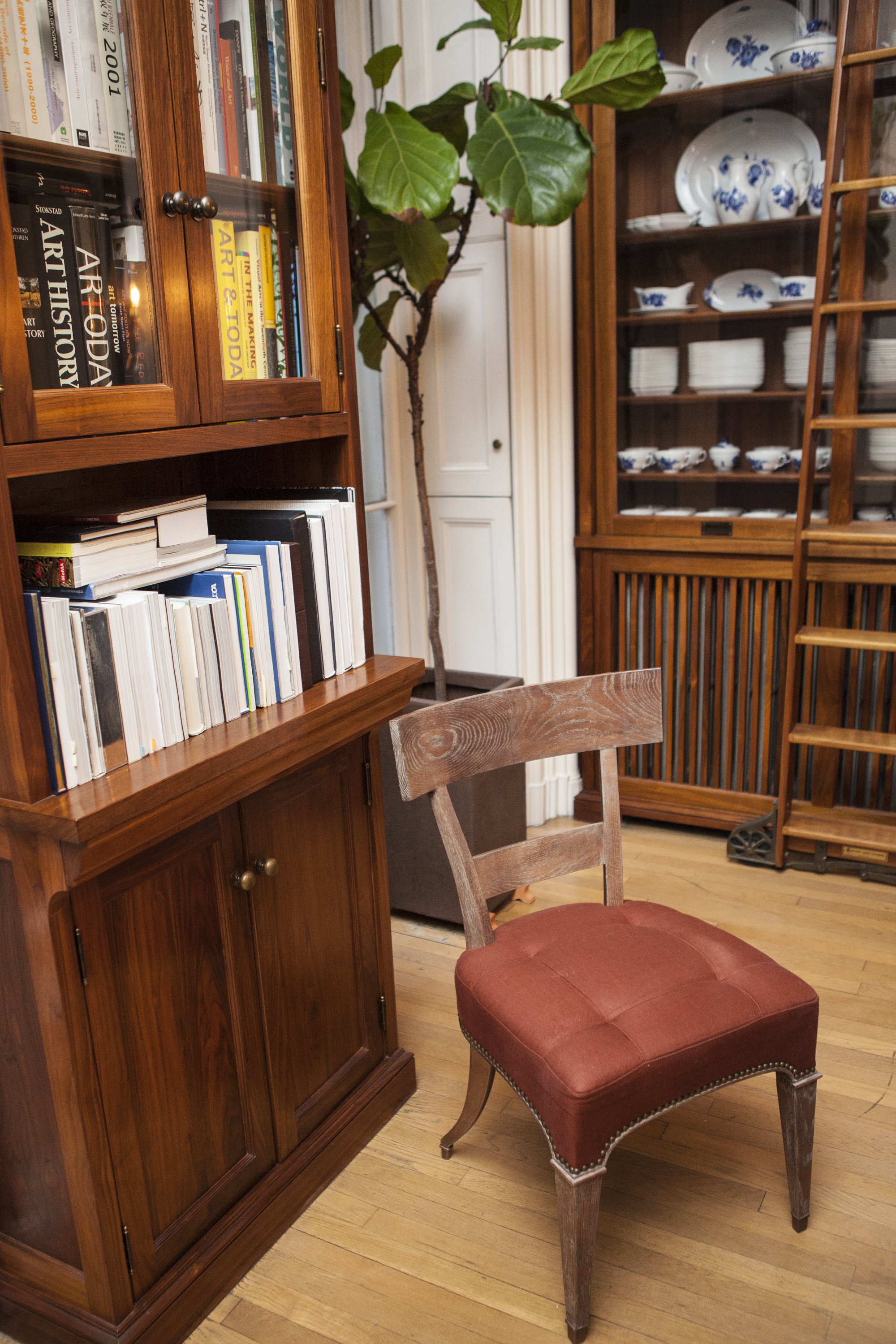 A klismos-inspired dining chair and custom cabinetry in the dining room