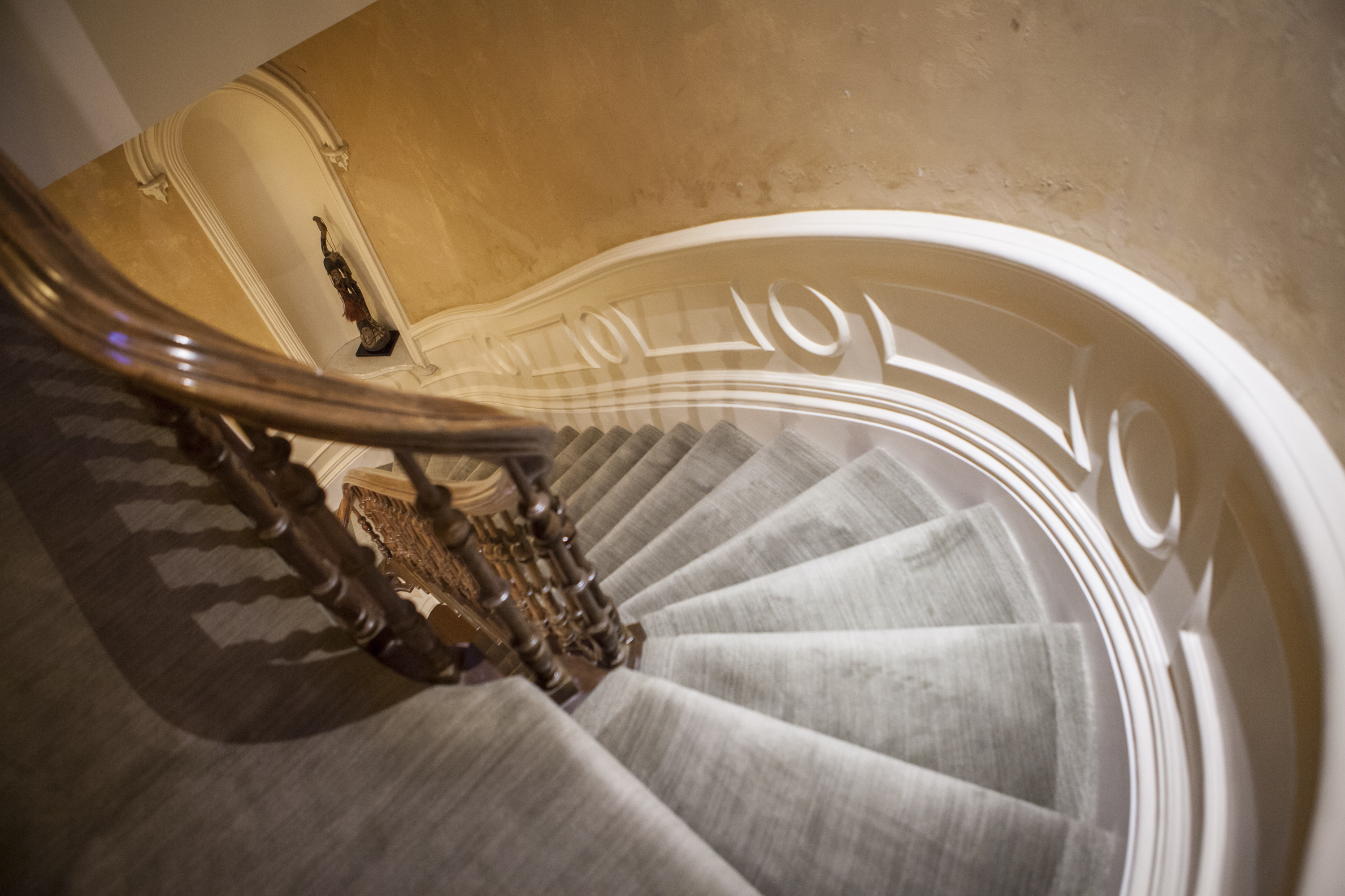 The swooping and intricately carved staircase