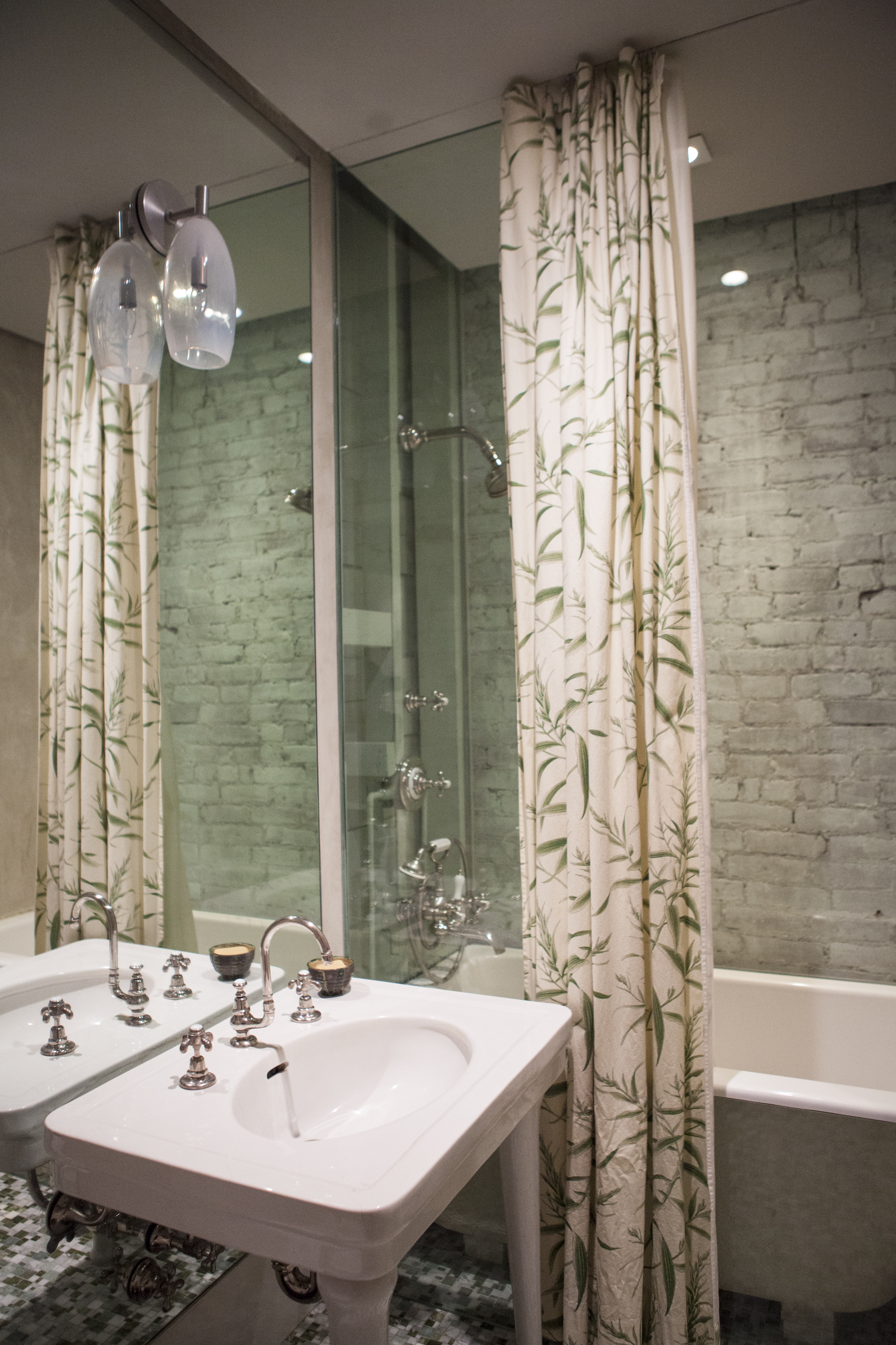 Textures and prints bring the upstairs bathroom to life.