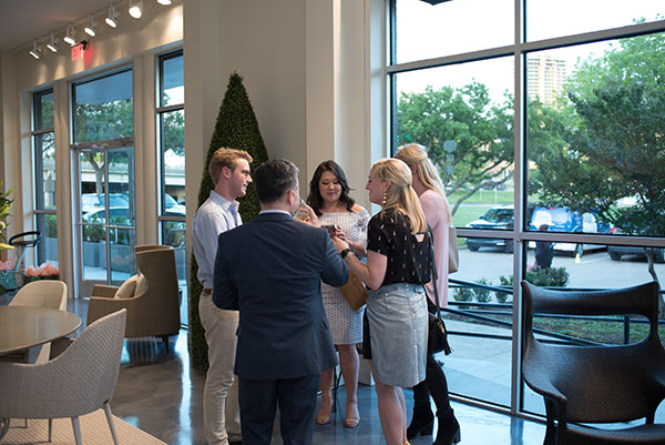 Guests at the front of the showroom