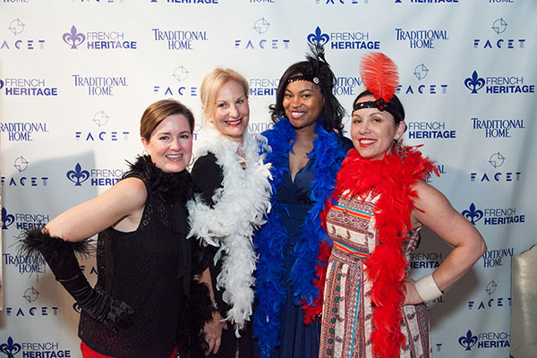 Guests use photo booth props for the Roaring '20s theme party.