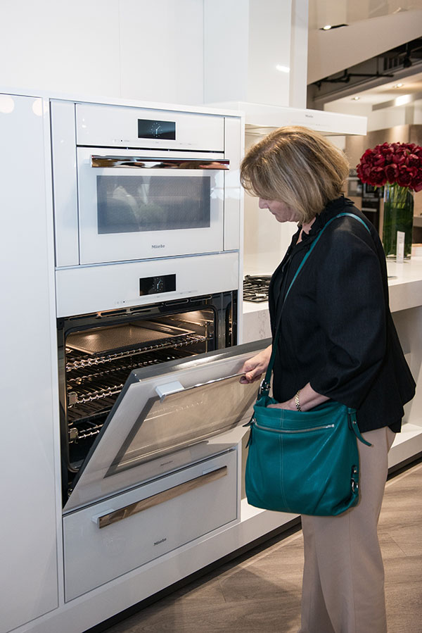 A guest looking at the appliances