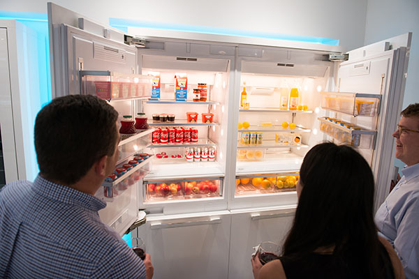 Attendees looking at a refrigerator