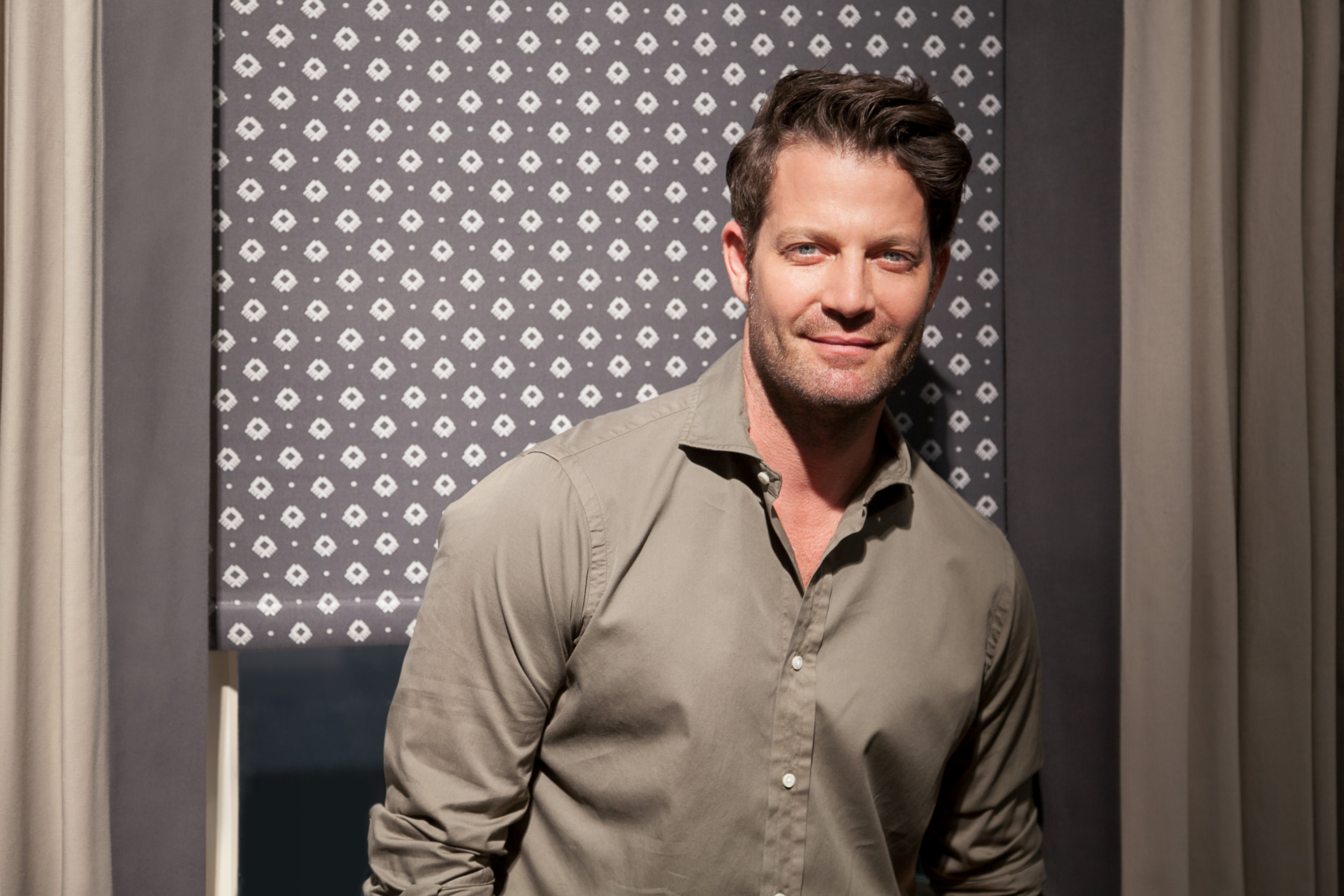 Nate Berkus in front of his new collection.