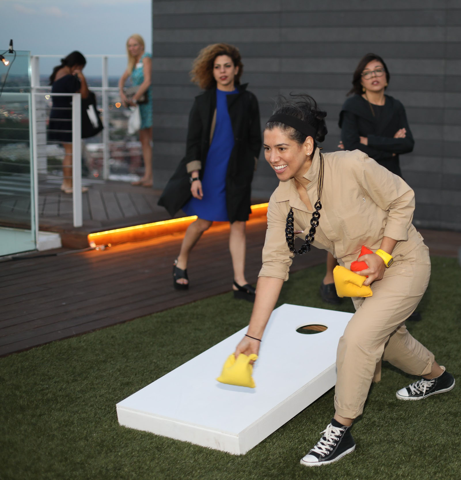 Priscilla Ghaznavi, Benjamin Moore color and design director, playing cornhole