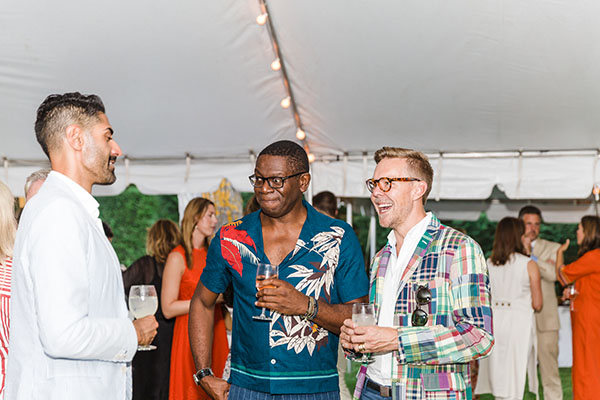 Designer Rayman Boozer of Apartment 48 (center) chats with Jaithan Kochar and Eddie Ross