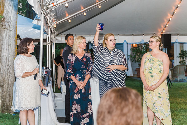 Alexa Hampton raises a glass to toast all the designers in this year's showhouse during the opening remarks with Beth McDonough, Michelle Newbery and Jill Waage.