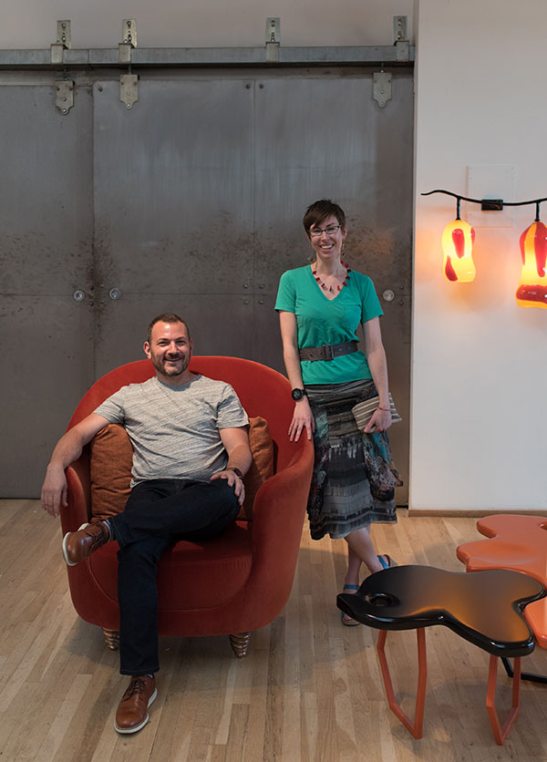 NYSID students Pete Hassler and Tove Hermanson with an Elizabeth Garouste club chair.