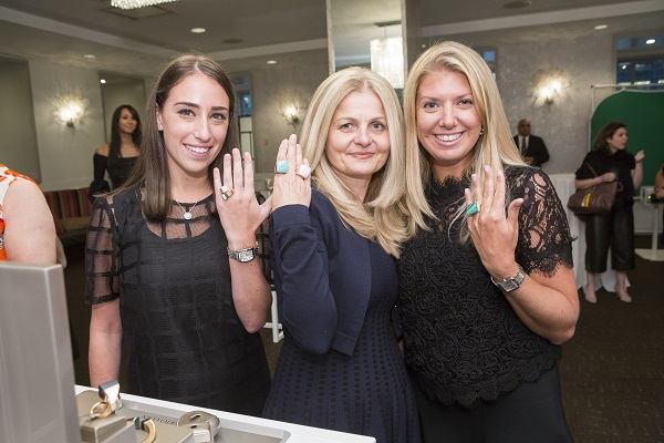 Attendees show off the new Roberto Coin collection.