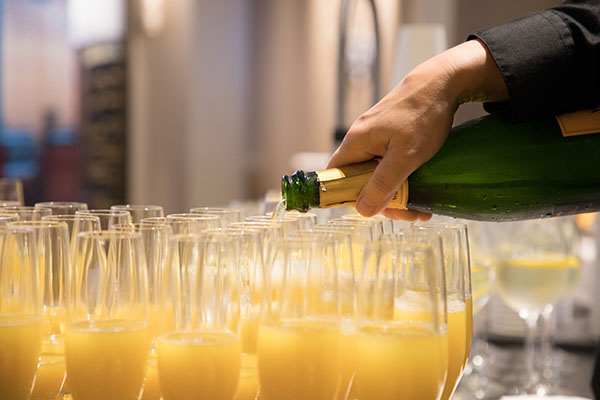 Mimosas being poured for guests