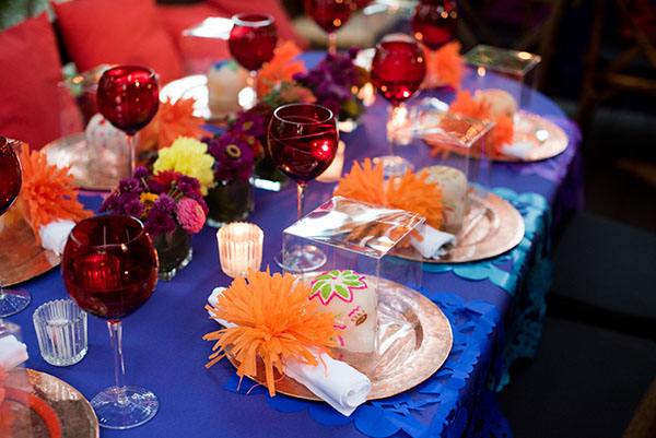 Colorful tabletop and sugar skull favors during Thompson Traders's Dia de los Muertos celebration.