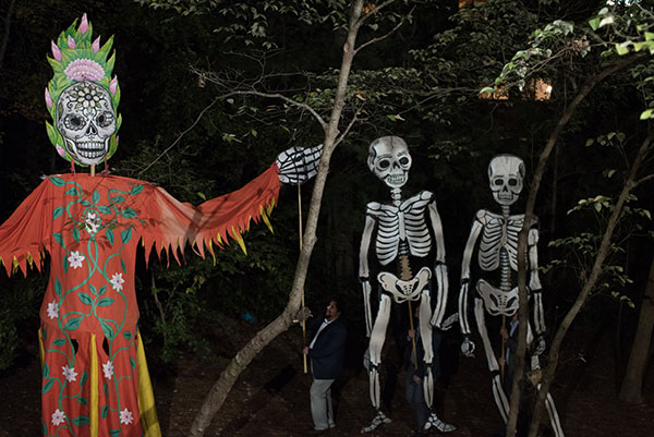 The giant Dia de los Muertos parade was held before dinner.