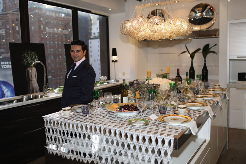 Designer Asler Valero wanted to mix the sleek white kitchen with very sophisticated elements. Cartier La Maison de L'Art Deco porcelain, along with the emerald green crystal glasses by Baccarat, were perfect to achieve the look.