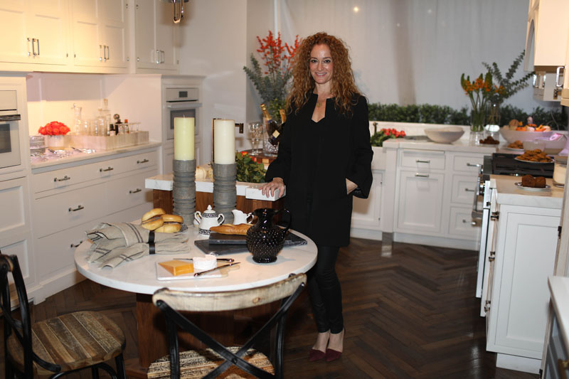Jennifer Flanders's kitchen vignette was inspired by getting ready for a gathering of loved ones. As a contrast to the warm tones of her beautiful fall floral arrangements, Flanders opted for black-and-white place settings—Black Aves by Royal Crown Derby and Black Cut by Waterford, all from Replacements.