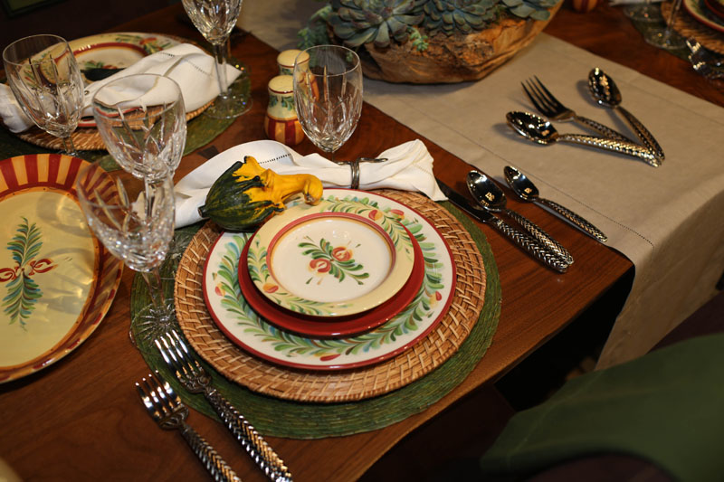 Tabletop styled by Julie Schuster in brilliant shades of burnt reds, mustard yellows and sage greens to replicate a Tuscan garden party