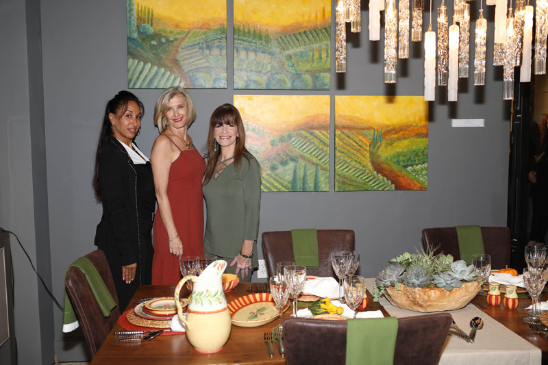 Designer Julie Schuster (center) with design associate Maggie Vergara and artist Debbie Viola
