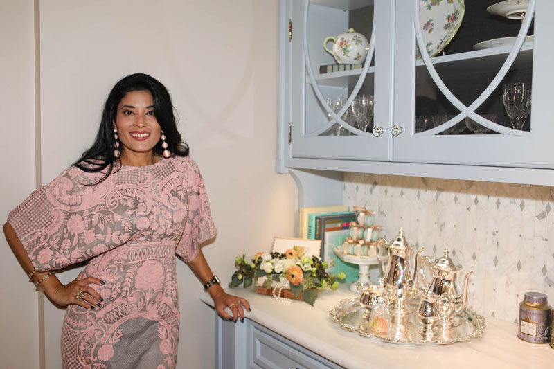 Designer Rajni Alex in the kitchen she styled