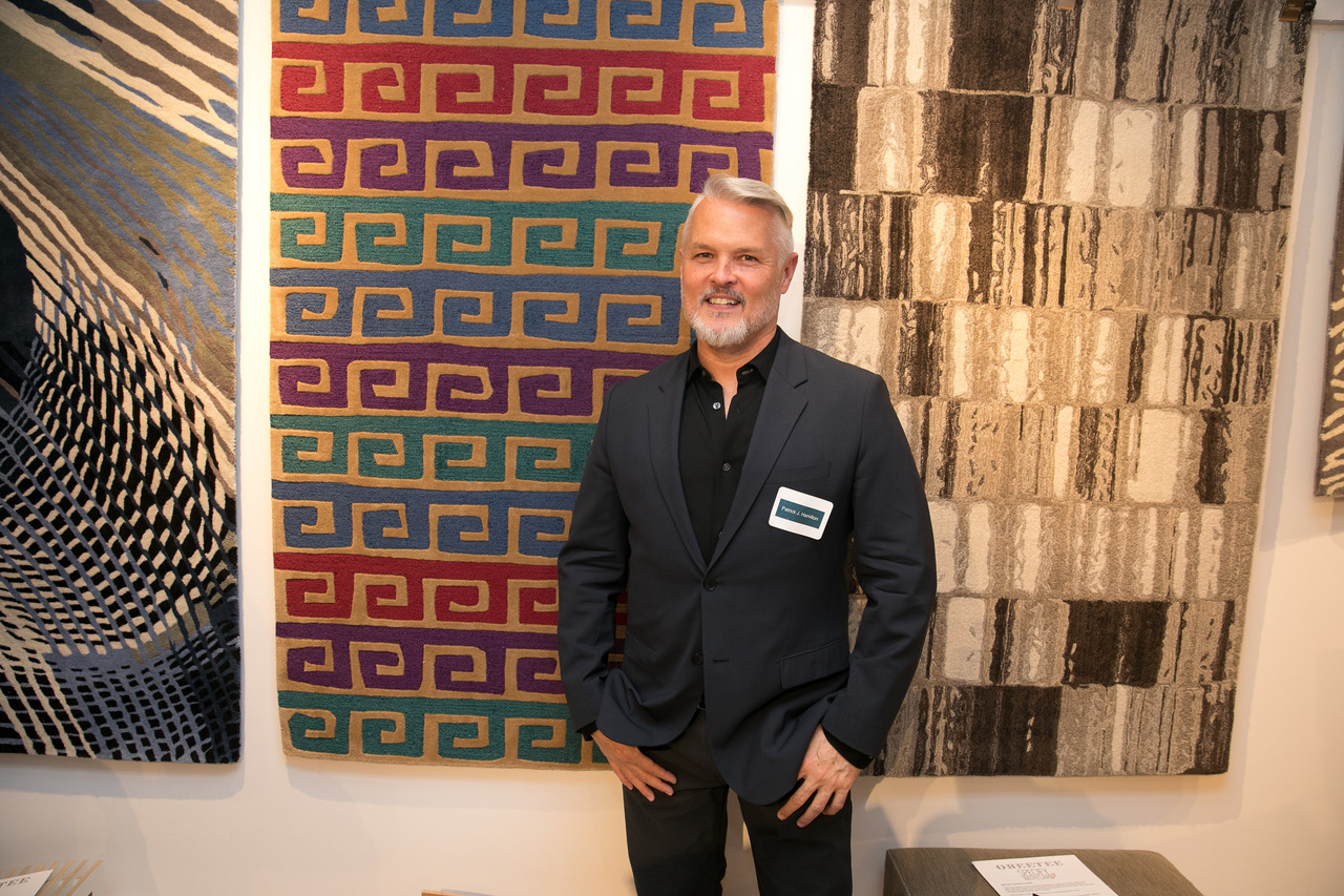 Patrick Hamilton in front of his rug design