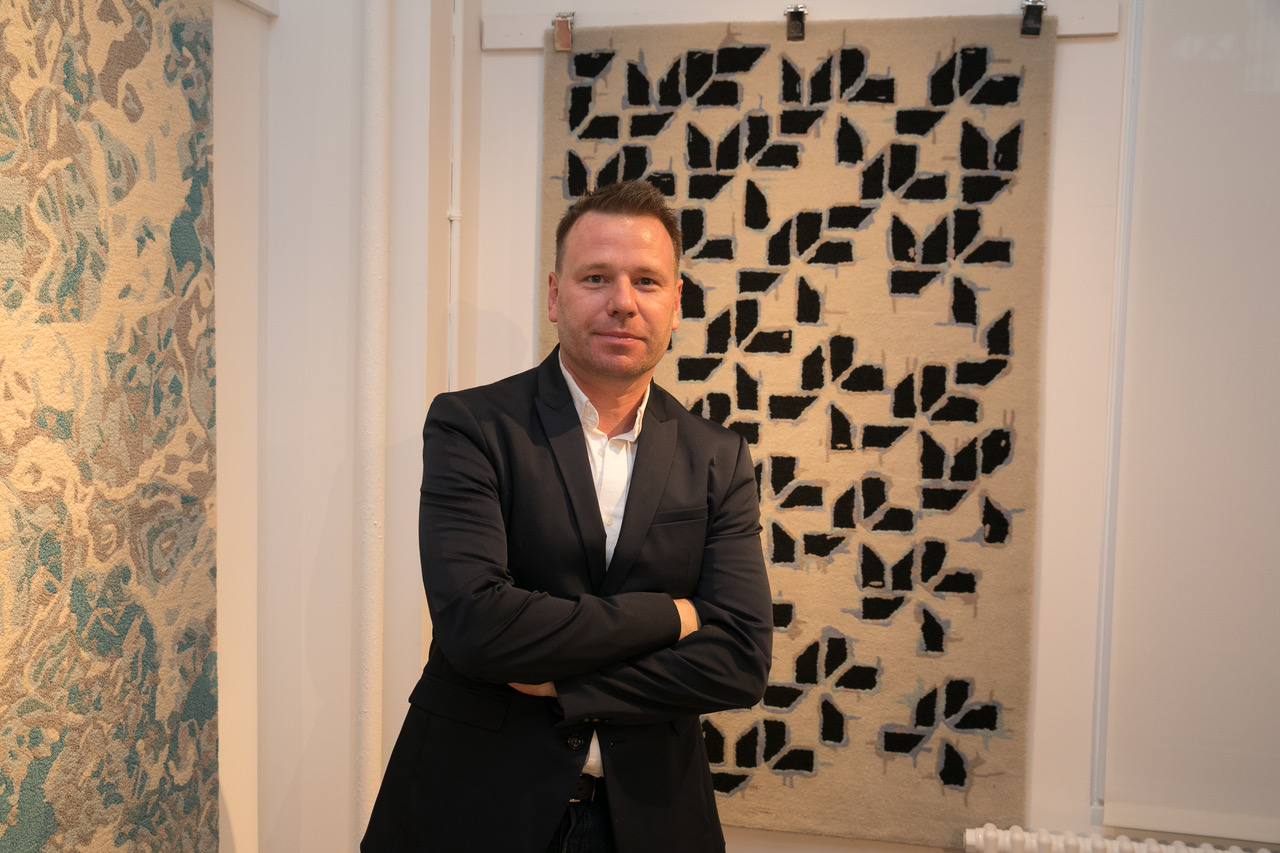 William Reue with his rug design