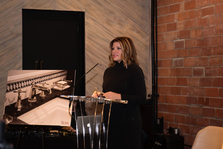 Denise McGaha welcomes guests to the ROHL Auth Lux Summit in Dallas.