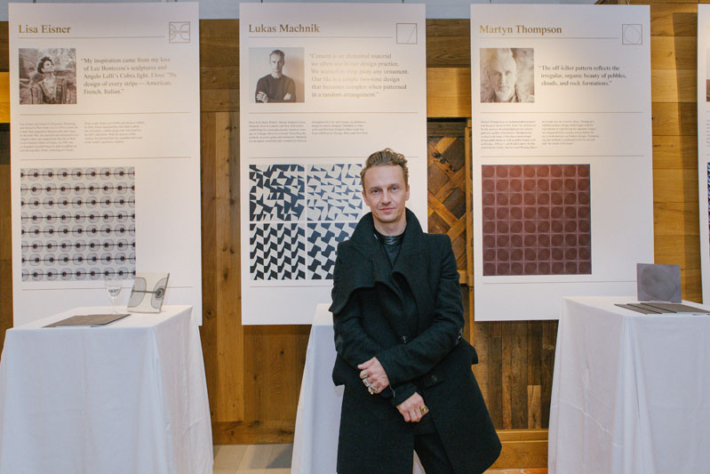 Lukas Machnik in front of his tile design