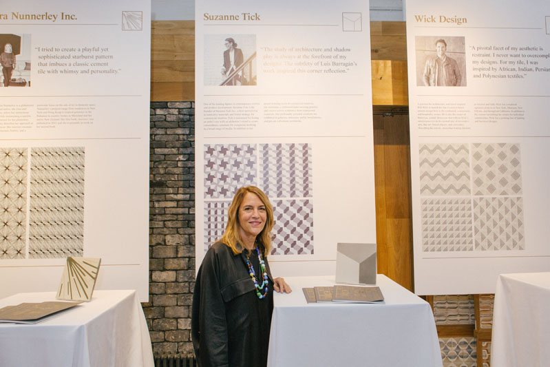 Suzanne Tick in front of her tile design