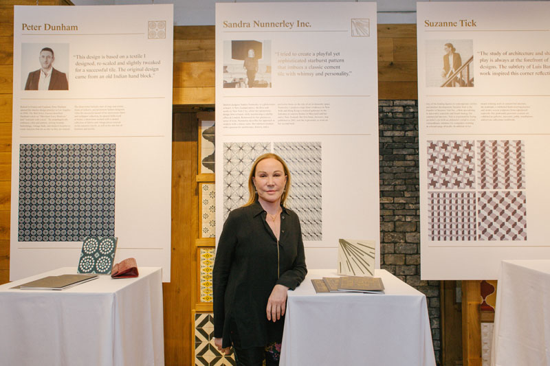 Sandra Nunnerley in front of her tile design